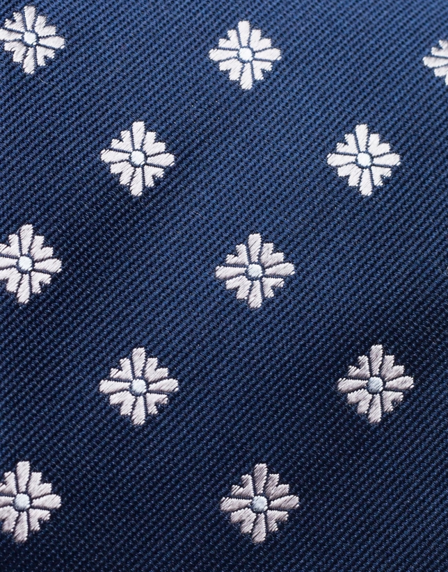 Cravate en soie bleu jacquard de fleurs grises