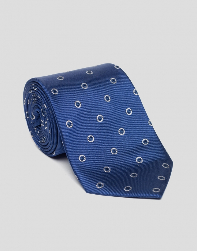 Blue silk tie with silver jacquard circles