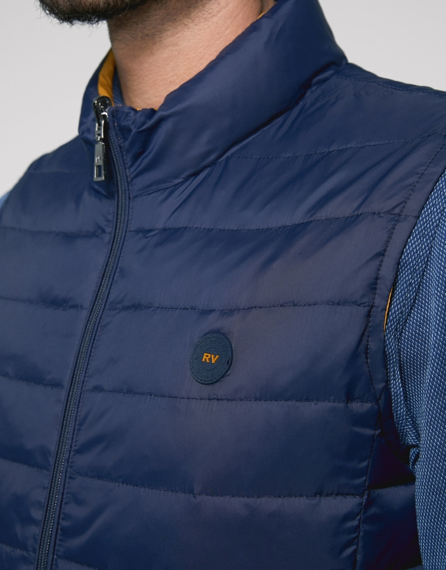 Navy blue and yellow, reversible, sport vest