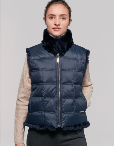 Navy blue quilted and fur reversible vest