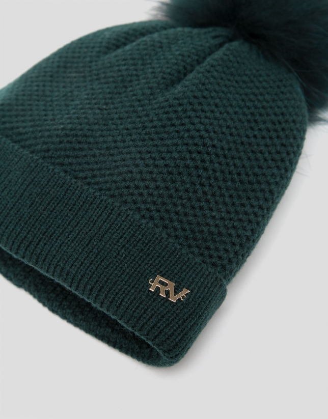 Green knit cap with pompom
