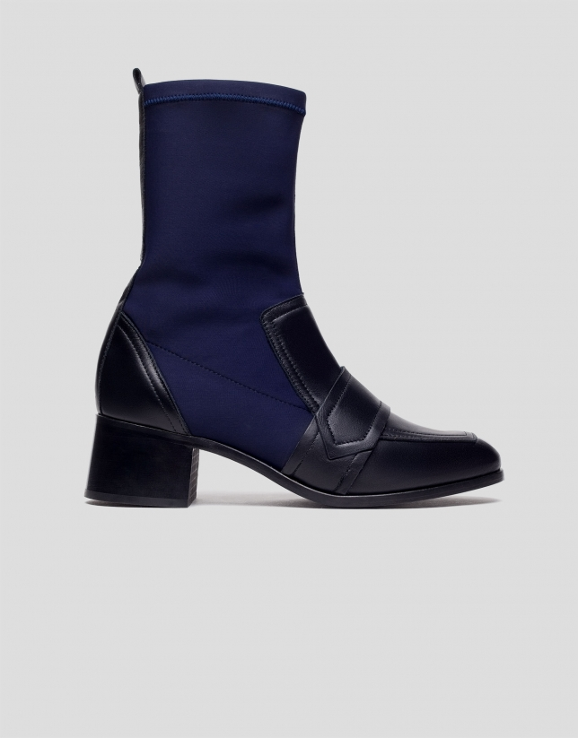 Blue and black mid-calf boots