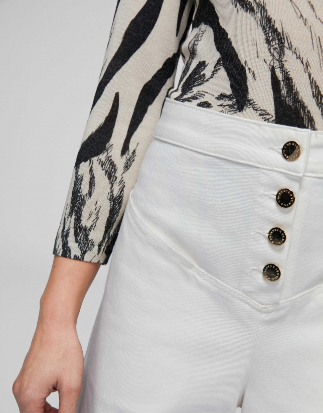 Cream-colored, bell-bottom jeans, with high waist