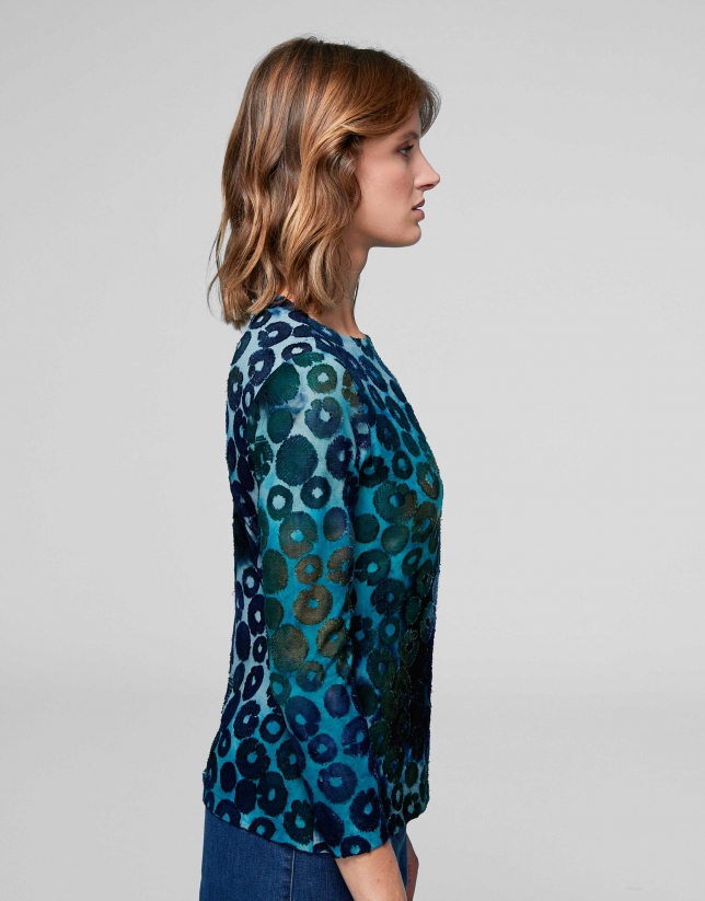 Blue knit top with spotted print