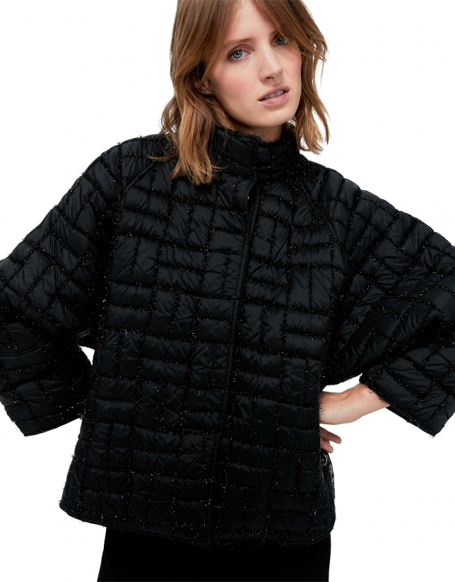 Short black quilted jacket