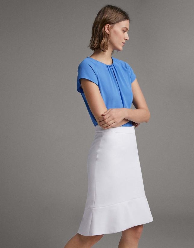 Falda corta blanca con volante