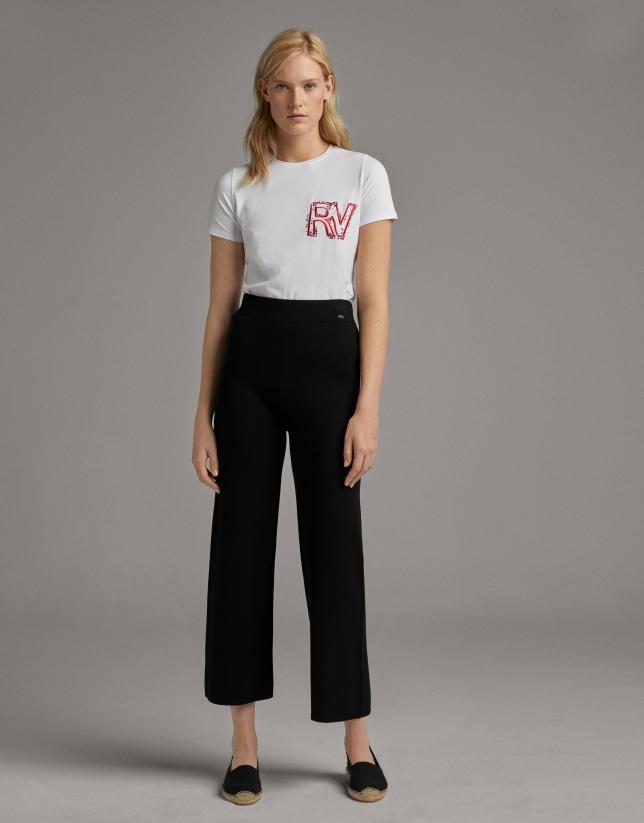 Black knit, bell bottom pants