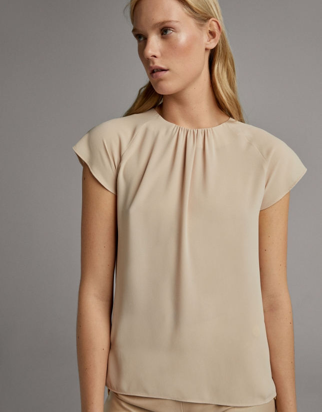 Beige blouse with short raglan sleeves