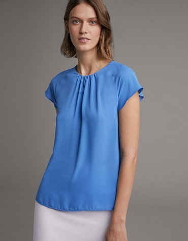 Blue blouse with short raglan sleeves