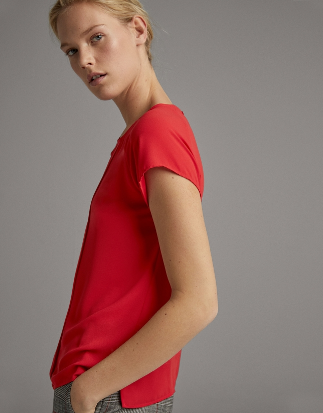 Red blouse with short sleeves
