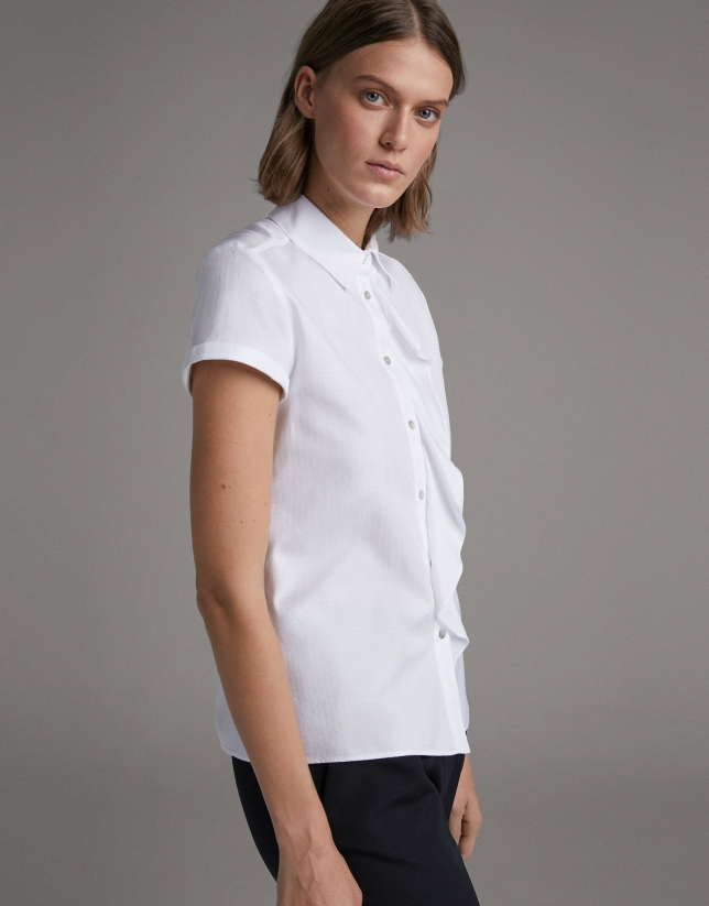 Loose white blouse with short sleeves