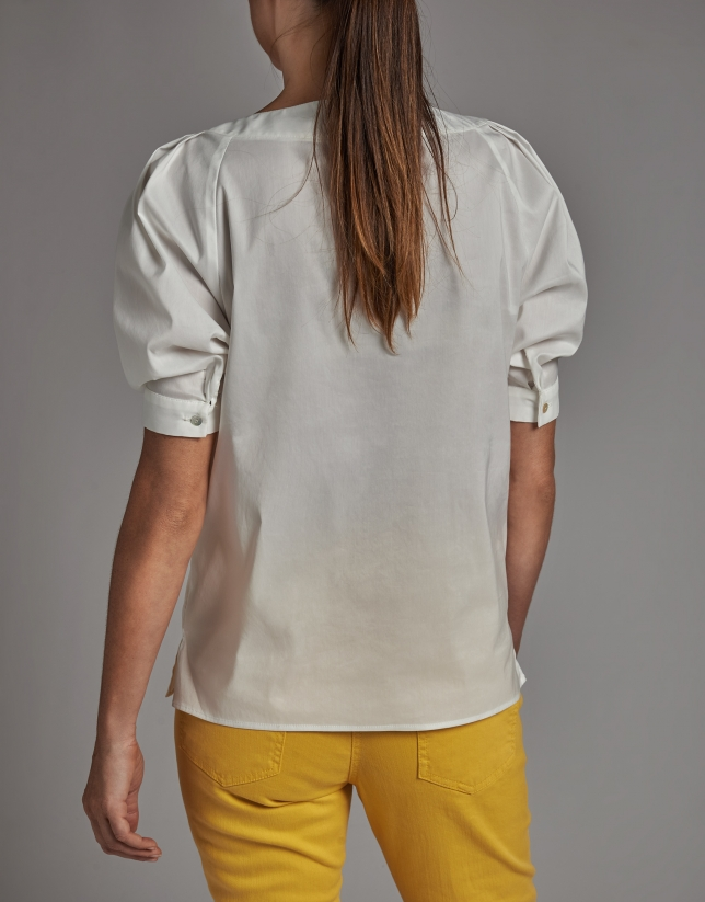 White shirt with boat neck and bow