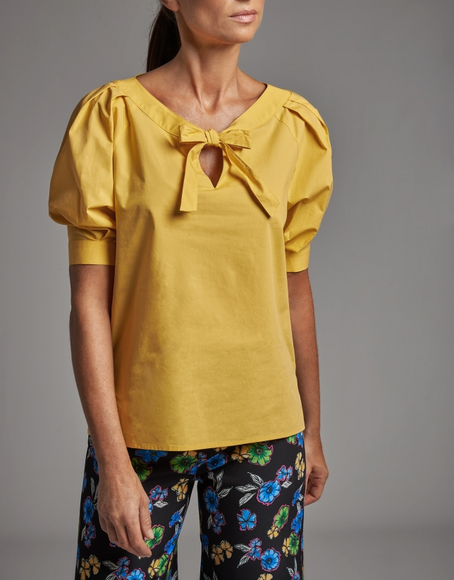 Yellow shirt with boat neck and bow