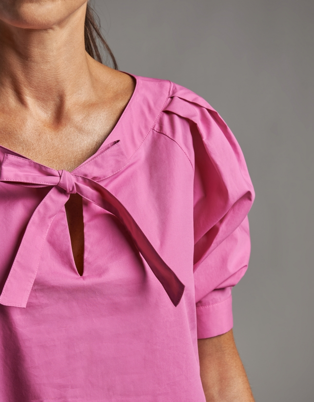 Fuchsia shirt with boat neck and bow