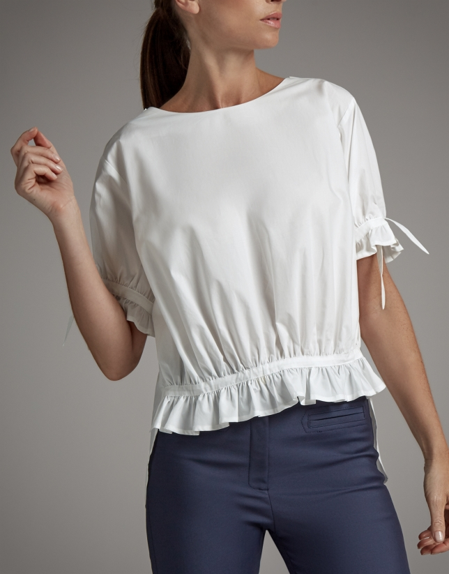 White asymmetric blouse with puffed sleeves