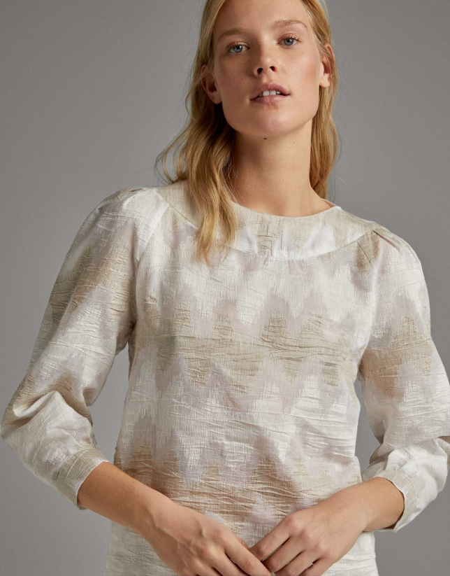 Beige shirt with boat neck and puffed sleeves