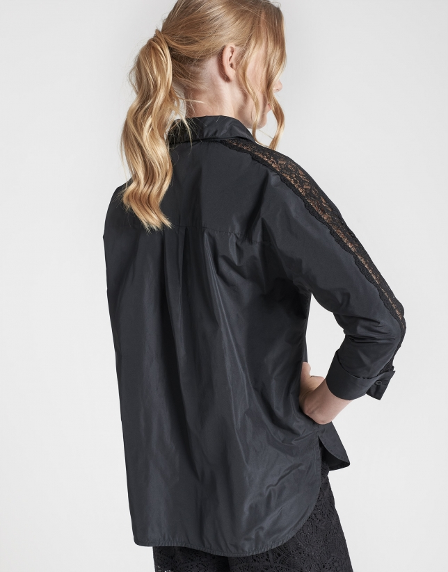 Black shirt with bat sleeves and embroidery