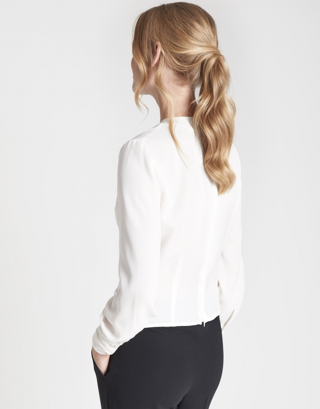 Beige, draped shirt with long sleeves