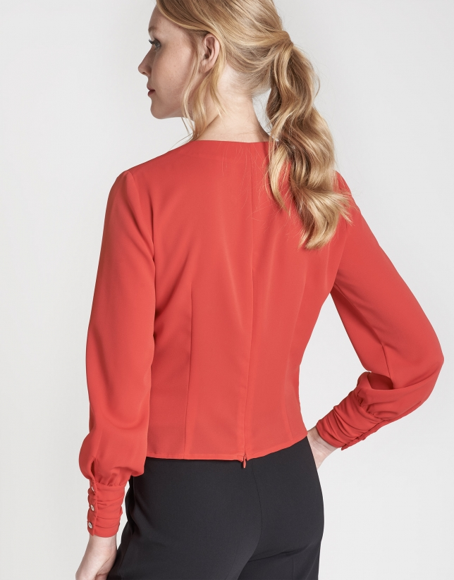 Red, draped shirt with long sleeves
