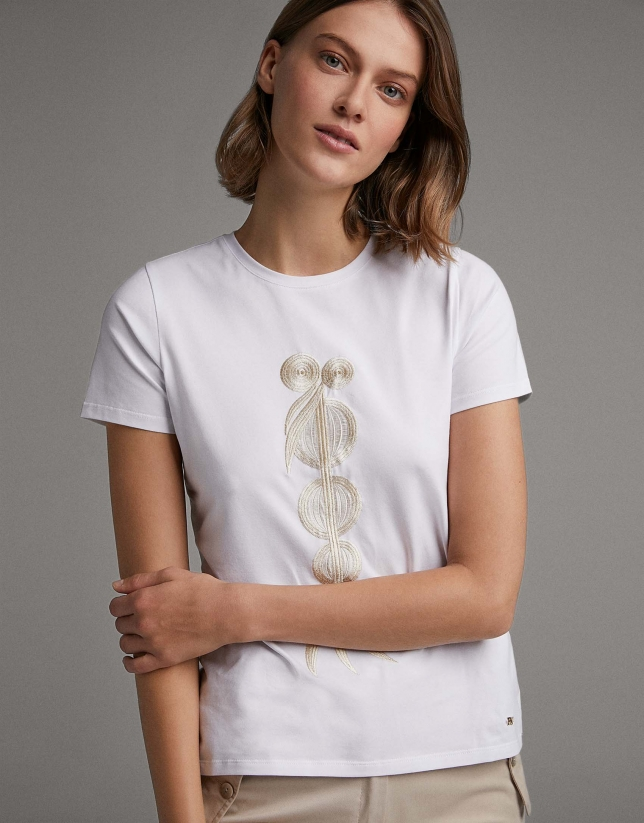 White top with beige ethnic embroidery