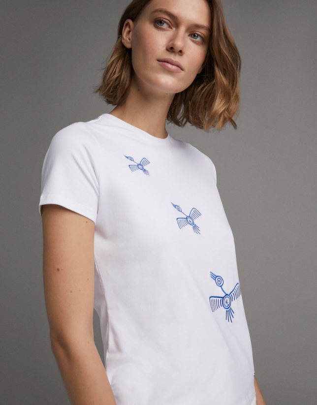 White top with embroidered blue birds
