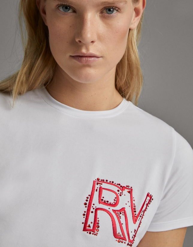White shirt with embroidered pink RV logo
