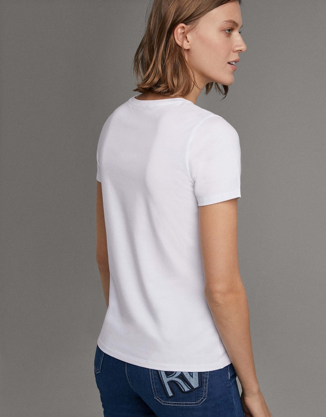 White shirt with embroidered blue RV logo
