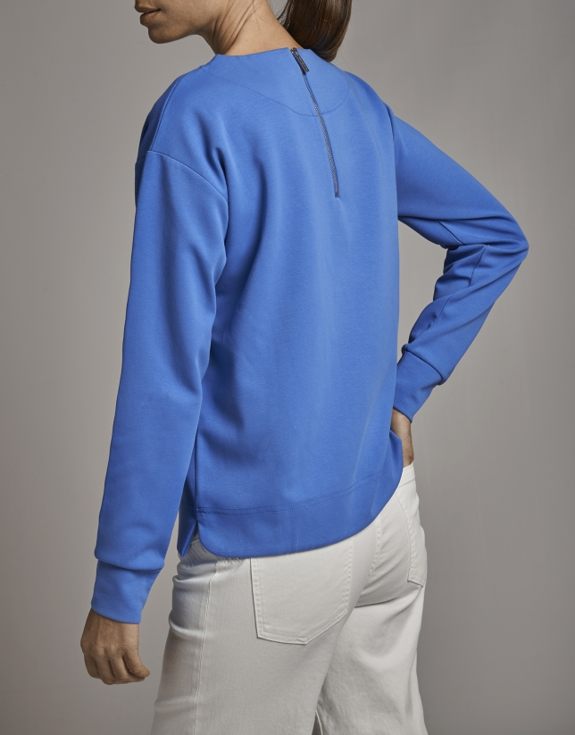 Sapphire blue sweatshirt with ethnic embroidery