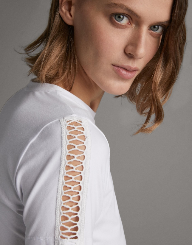 White top with lace on the front and sleeves