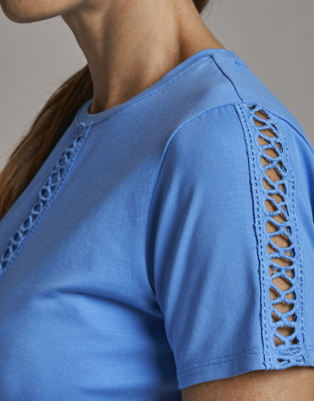 Blue top with lace on the front and sleeves