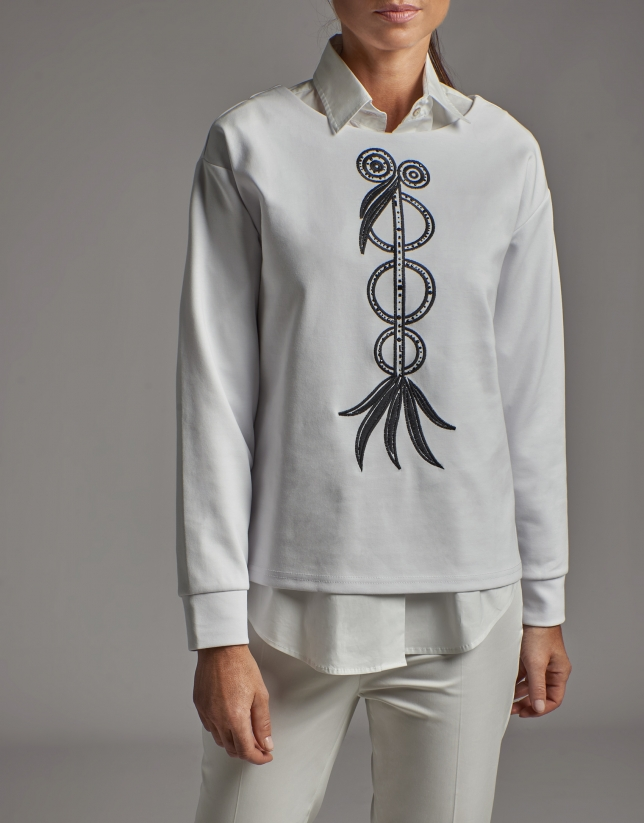 White sweatshirt with embroidered bird print and rhinestones