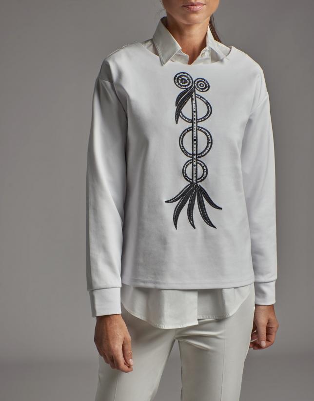 White sweatshirt with embroidered bird print and rhinestones