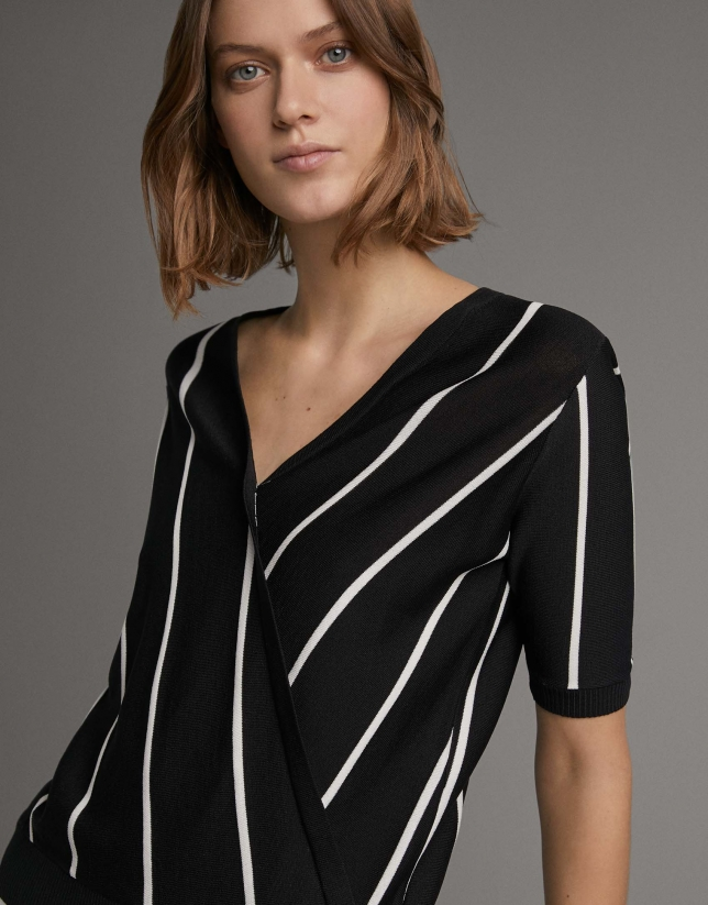 White and black striped sweater and crossover neckline