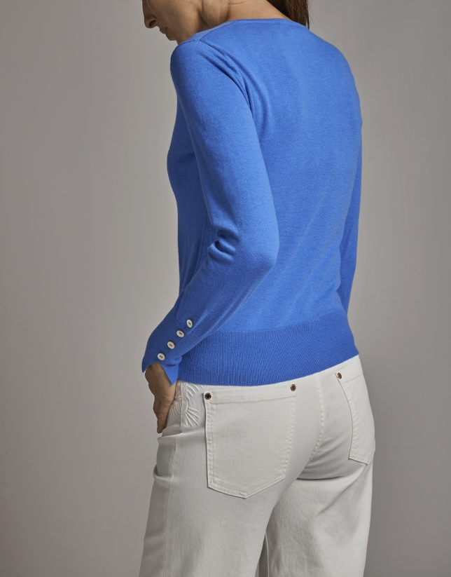 Blue sweater with slits on cuffs