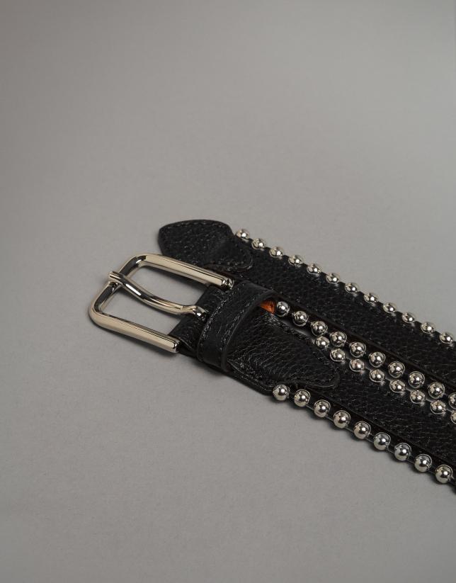 Cinturón piel negra con perfil metálico