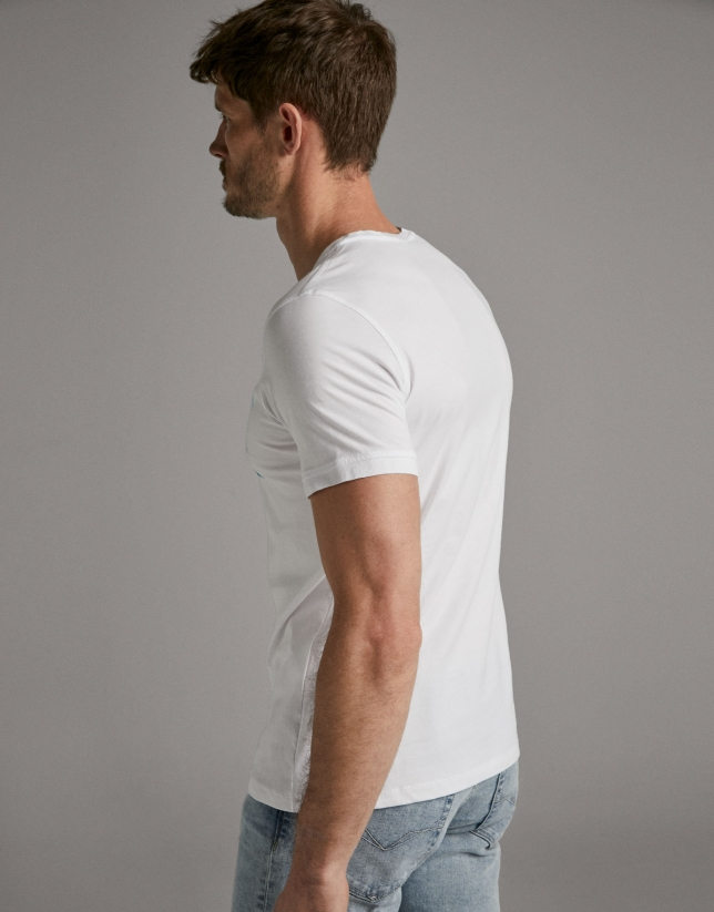 White t-shirt with turquoise brush-strokes