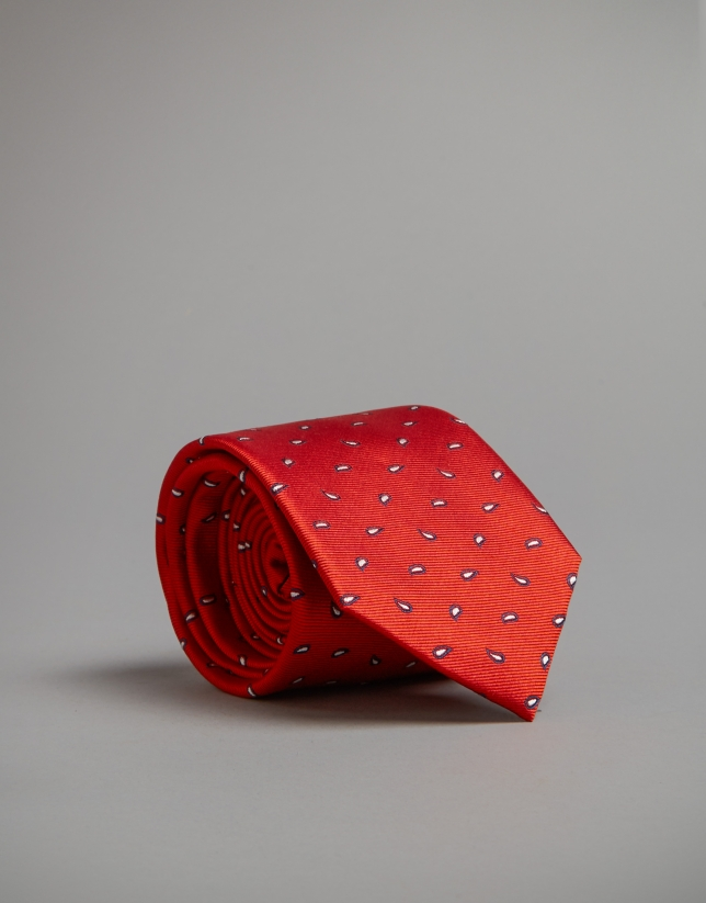 Red tie with navy blue and beige dots