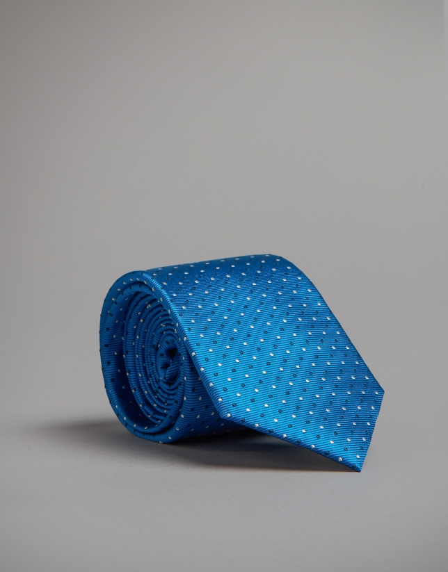 Turquoise tie with white and navy blue polka dots
