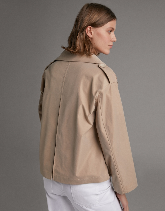 Short beige parka with double row of buttons
