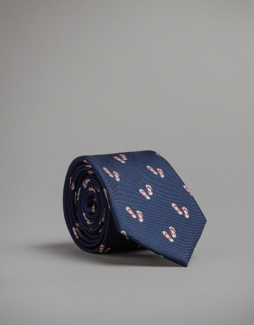 Blue tie with red and gray jacquard thong print