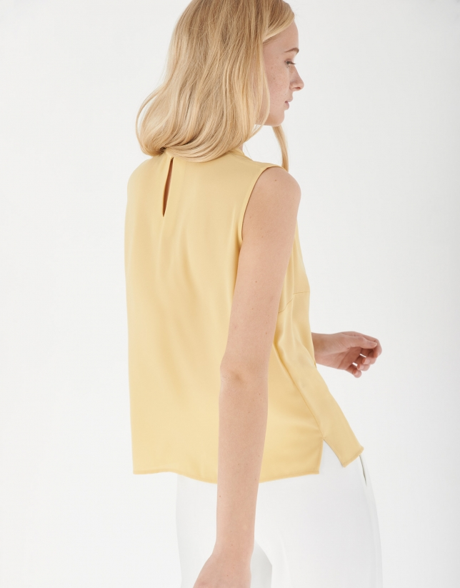 Vanilla-cream coloured top with pleated front