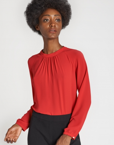 Red long-sleeved blouse