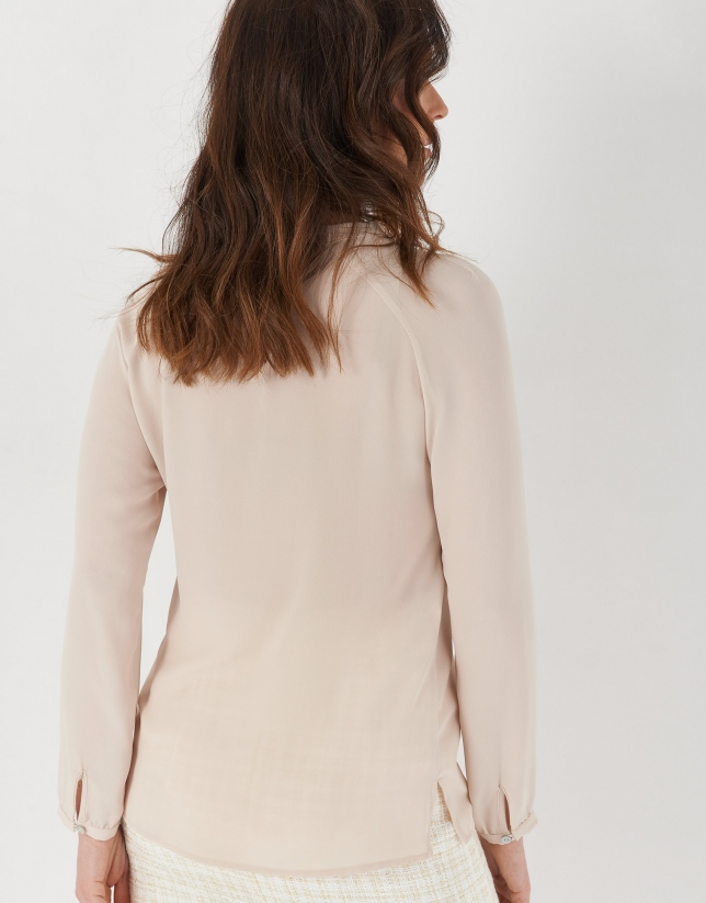 Beige long-sleeved blouse