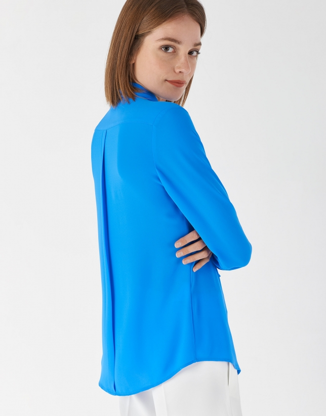 Deep blue blouse with jabot collar