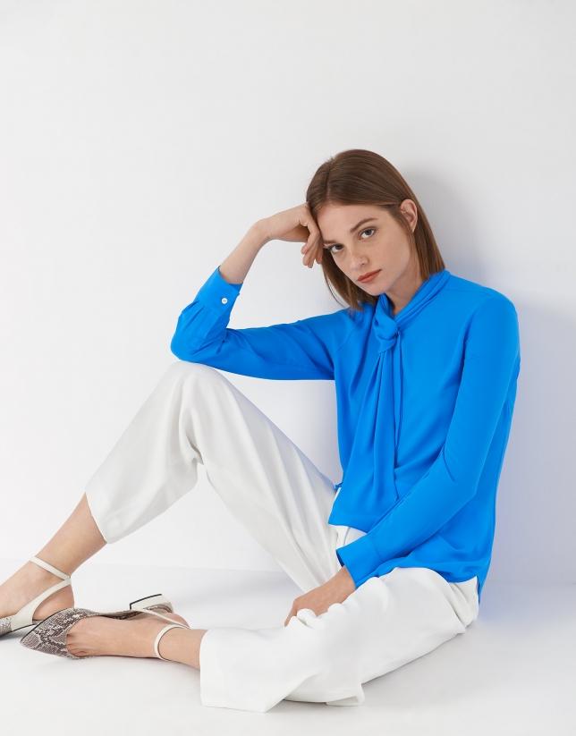 Deep blue blouse with jabot collar