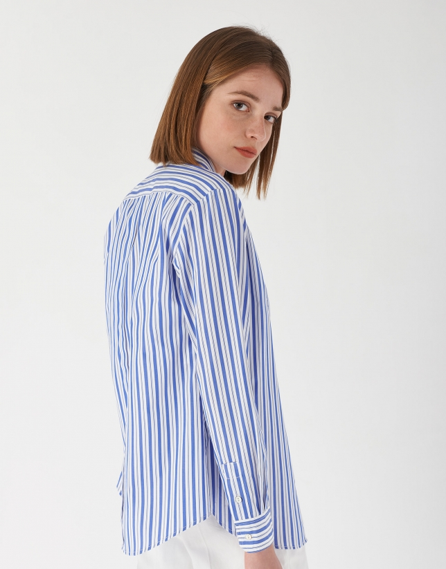 Blue and white striped shirt with logo