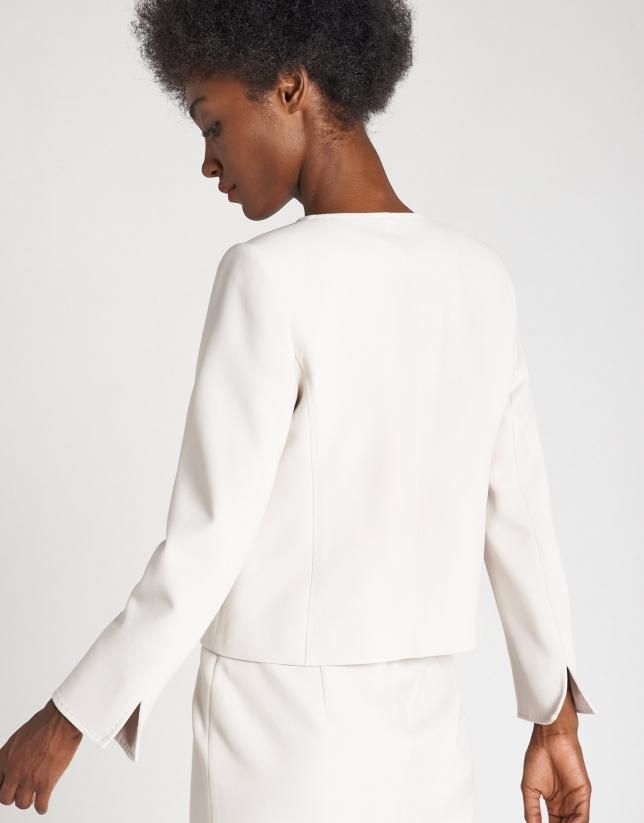 Beige short jacket with back-stitching