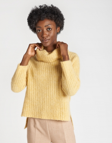 Yellow sweater with asymmetric bottom