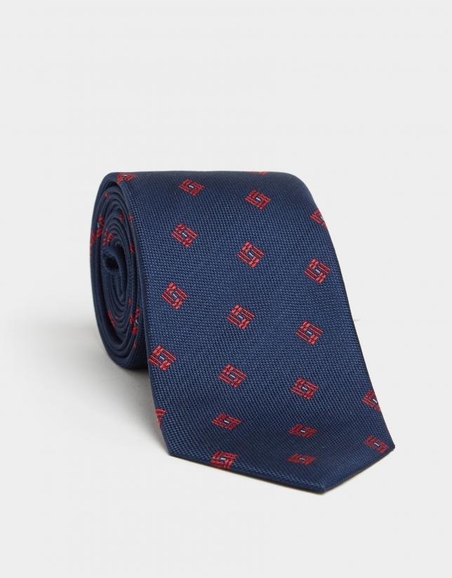 Navy blue silk tie with red geometric print