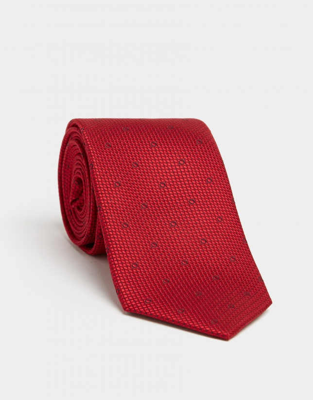 Red silk tie with micro-design of navy blue circles and dots